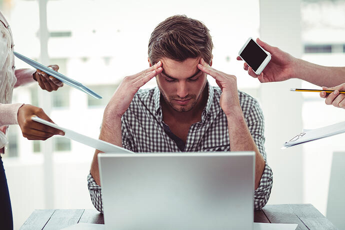 Businessman stressed out at work in casual office-1