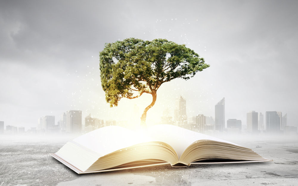 Concept of education and knowledge with tree growing from book-1