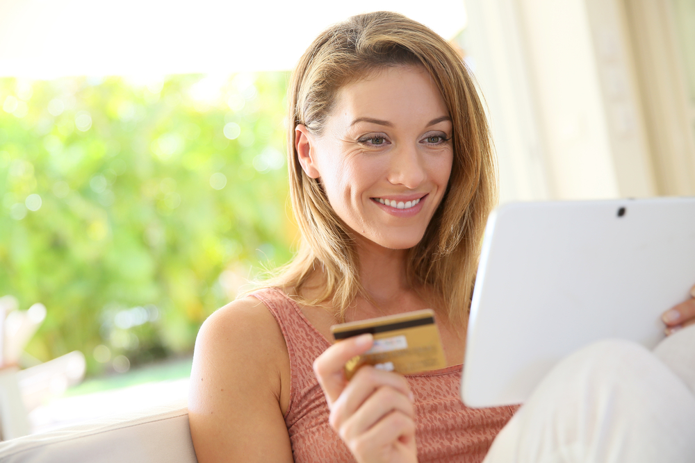 Portrait of woman shopping on internet with tablet