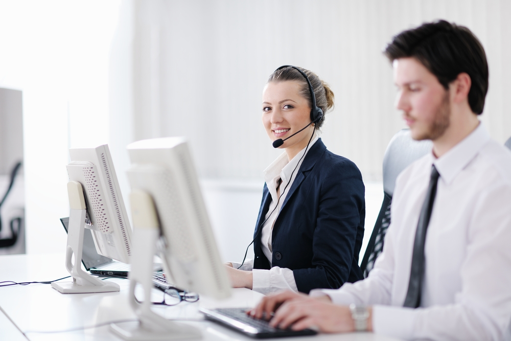 business people group with  headphones giving support in  help desk office to customers, manager giving training and education instructions-5